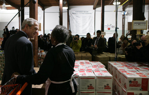 "President George W. Bush talks with 85-year-old Doris Lewis Monday, Nov. 19, 2007, during a stop at the Central Virginia Community Food Bank in Richmond, Va. ""You have a sweet heart,"" the President told the volunteer, who was celebrating her birthday at the warehouse. White House photo by Chris Greenberg"