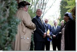 President George W. Bush speaks with actors Jim Curtis and Mattie Jones during his visit Monday, Nov. 19, 2007, to the Thanksgiving Shrine at Berkeley Plantation in Charles City, Virginia. The President made his Thanksgiving remarks at the landmark first settled in 1619 by Englishman and Capt. John Woodlief. White House photo by Chris Greenberg
