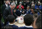 Youngsters with Camp Fire USA and other guests join President George W. Bush around May, the 2007 National Thanksgiving turkey, during Rose Garden festivities surrounding its official pardoning Tuesday, Nov. 20, 2007. White House photo by Joyce N. Boghosian