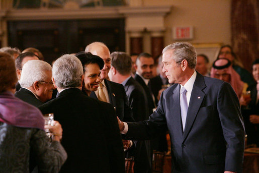 President George W. Bush speaks with U.S. Secretary of State Condoleezza Rice, center, joined by Palestinian President Mahmoud Abbas, left, and Israeli Prime Minister Ehud Olmert, following President Bush's address at the Secretary of State's Dinner Monday evening, Nov. 26, 2007 at the State Department in Washington, D.C., welcoming the participants attending the Annapolis Conference. White House photo by Chris Greenberg