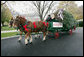 Scott D. Harmon of Brandy Station, Va., drives a horse-drawn carriage delivering the official White House Christmas tree Monday, Nov. 26, 2007, to the North Portico of the White House. The 18-foot Fraser Fir tree, from the Mistletoe Meadows tree farm in Laurel Springs, N.C., will be on display in the Blue Room of the White House for the 2007 Christmas season. White House photo by Chris Greenberg
