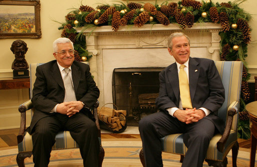 "President George W. Bush and President Mahmoud Abbas of the Palestinian Authority meet in the Oval Office of the White House Monday, Nov. 26, 2007. In welcoming his fellow leader to the White House, President Bush said, ""Thank you for coming, and thank you for working hard to implement a vision for a Palestinian state. We want the people in the Palestinian Territories to have hope. And we thank you for your willingness to sit down with Israel to negotiate the settlement."" White House photo by Eric Draper"