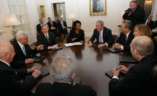 President George W. Bush shares a light moment with Palestinian President Mahmoud Abbas, second from left, Israel's Prime Minister Ehud Olmert, lower right during a meeting Tuesday, Nov. 27, 2007, during the Annapolis Conference in Annapolis, Maryland. With them are senior officials from Israel, Palestine and the United States, including National Security Adviser Stephen Hadley, third from left, and United States Secretary of State Condoleezza Rice. White House photo by Chris Greenberg