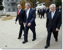 President George W. Bush, Prime Minister Ehud Olmert, left, of Israel, and President Mahmoud Abbas of the Palestinian Authority walk to Bancroft Hall on the grounds of the U.S. Naval Academy in Annapolis, Maryland, during the Annapolis Conference Tuesday, Nov. 27, 2007.  White House photo by Chris Greenberg