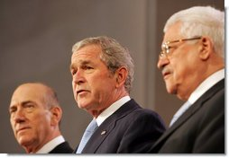 "President George W. Bush reads from a joint statement by Israeli Prime Minister Ehud Olmert and Palestinian President Mahmoud Abbas, in which the leaders pledged to resume Mideast peace talks. The statement came during the Annapolis Conference in Annapolis, Maryland, and read, in part: ""We express our determination to bring an end to bloodshed, suffering and decades of conflict between our peoples; to usher in a new era of peace, based on freedom, security, justice, dignity, respect and mutual recognition; to propagate a culture of peace and nonviolence; to confront terrorism and incitement, whether committed by Palestinians or Israelis."" White House photo by Chris Greenberg"