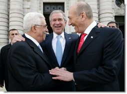 President George W. Bush congratulates President Mahmoud Abbas, left, of the Palestinian Authority, and Prime Minister Ehud Olmert of Israel following their agreement Tuesday, Nov. 27, 2007, to immediately resume long-stalled peace talks. The agreement came during the Annapolis Conference held in Annapolis, Maryland.  White House photo by Chris Greenberg