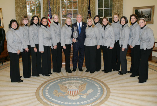 "President George W. Bush welcomes the members of the U.S. Solheim Cup team to the Oval Office, Thursday, Nov. 29, 2007, to honor them for their 2007 Solheim Cup victory in Halmstad, Sweden, the most prestigious team award in women's golf. Left to right are golfers Patricia ""Pat"" Hurst, Paula Creamer, Nicole Castrale, Sheryl ""Sherri"" Steinhauer, Brittany Lincicome, Morgan Pressel, Mary Beth ""Betsy"" King, Laura Diaz, Angela Stanford, Natalie Gulbis, Stacy Prammanasudh, Juli Inkster and Cristie Kerr. White House photo by Eric Draper"