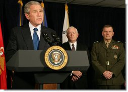 President George W. Bush is joined at the Pentagon Thursday, Nov. 29, 2007, by Secretary of Defense Robert Gates and Gen. James Cartwright, Vice Chairman of the Joint Chiefs of Staff, as he delivers a statement after briefings at the Department of Defense.  White House photo by Chris Greenberg