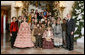 "President George W. Bush and Mrs. Laura Bush pose for a photo with the Ford's Theater cast members of ""A Christmas Carol,"" following their performance Monday, Dec. 3, 2007, at the White House Children's Holiday Reception. White House photo by Shealah Craighead"