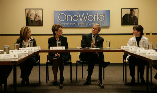 "President George W. Bush participates in a meeting on health care Wednesday, Dec. 5, 2007, during a visit to the OneWorld Community Health Centers, Inc. in Omaha. Said the President afterwards, ""This center serves -- 85 percent of its people don't speak English as a first language. By far, the vast majority are low-income. And yet they're receiving first-class quality care. So I thank the docs and the nurses and the social workers, and all the people who are making this facility such a good one."" White House photo by Chris Greenberg"