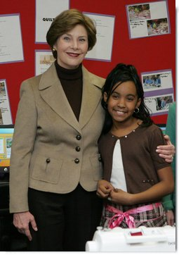 Mrs. Laura Bush embraces 10-year-old Taylor Rice, whose father is currently serving overseas in the Army Reserves, during a visit to the Learning Center at Andrews Air Force Base in Maryland, Wednesday, Dec. 5, 2007, where Mrs. Bush participated is a roundtable discussion on the special needs of military youth and families. White House photo by Joyce N. Boghosian