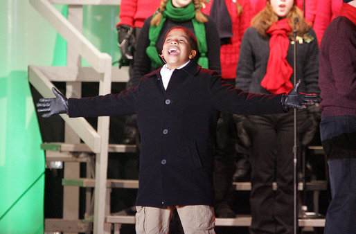 "Seventh-grader Julian Ivey, who just completed a 6-month run on Broadway as Simba in ""The Lion King,"" performs onstage Thursday, Dec. 6, 2007, at the Ellipse during the lighting of the National Christmas Tree. White House photo by Joyce N. Boghosian"