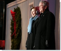 President George W. Bush and Mrs. Laura Bush arrive on stage at the Ellipse in Washington, D.C., Thursday, Dec. 6, 2007, for the lighting of the National Christmas Tree. White House photo by Shealah Craighead