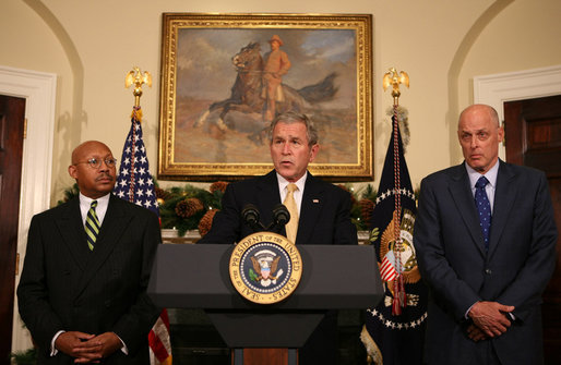 President George W. Bush is flanked by Secretary Alphonso Jackson, left, of the Department of Housing and Urban Development, and Secretary Hank Paulson of the Department of the Treasury, as he delivers a statement Thursday, Dec. 6, 2007, at the White House, on the Administration's efforts on housing. White House photo by Joyce N. Boghosian