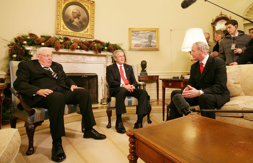President George W. Bush shares a moment with Ian Paisley, left, First Minister of Northern Ireland, and Martin McGuinness, Deputy First Minister of Northern Ireland, during their visit Friday, Dec. 7, 2007, to the Oval Office. White House photo by Chris Greenberg