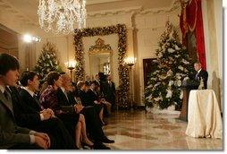 "President George W. Bush delivers remarks during the Menorah lighting Monday, Dec. 10, 2007, in the Grand Foyer of the White House. Said the President, ""Laura and I wish people of Jewish faith around the world a happy Hanukkah. May God bless you all."" White House photo by Chris Greenberg"