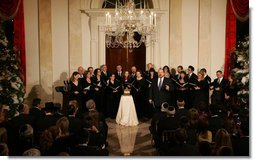 Tenor Alberto Mizrahi, the cantor at Chicago's historic Anshe Emet Synagogue, is joined by the Zamir Chorale as they entertain during the lighting of the Menorah Monday, Dec. 10, 2007, in the Grand Foyer of the White House. White House photo by Joyce N. Boghosian