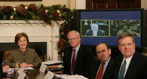 Mrs. Laura Bush is joined by Jim Jeffrey, Assistant to the President and Deputy National Security Advisor; Elliot Abrams, Deputy National Security Advisor for Global Democracy Strategy, and Dennis Wilder, Special Assistant to the President and Senior Director for East Asian Affairs, as she participates in a video conference on Burma in recognition of International Human Rights Day Monday, Dec. 10, 2007, in the Roosevelt Room of the White House. Speaking via video are U.S. Ambassador to Thailand Skip Boyce and Dr. Cynthia Maung, Founder and Director of the Mae Tao Clinic in Mae Sot,Thailand. White House photo by Chris Greenberg