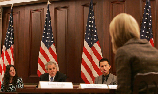 President George W. Bush participates in a meeting Tuesday, Dec. 11, 2007, on the Monitoring the Future Study on teen drug use. The study tracks drug use among America's young people and according to the latest study, there are more than 800,000 fewer young people using illicit drugs today than there were in 2001. With the President are Sara Johnson, left, 16, from Michigan, and Justin Calderon, 19, from California, both recovering addicts. White House photo by Chris Greenberg