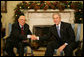 "President George W. Bush and President Giorgio Napolitano exchange handshakes during the Italian leader's visit Tuesday, Dec. 11, 2007, to the White House. President Bush told his counterpart, ""It's my honor to welcome you. Bilateral relations with the United States and Italy are very good. We have a lot of interchange between our countries, with business as well as travel."" White House photo by Eric Draper"