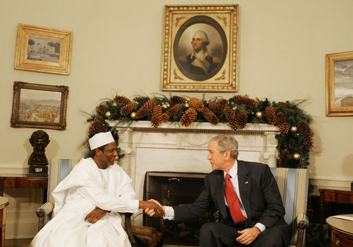 "President George W. Bush shakes hands with President Umaru Yar'Adua of Nigeria, as he welcomes him to the Oval Office Thursday, Dec. 13, 2007, at the White House. Said President Bush, ""Mr. President, I am impressed by your commitment to reform, your adherence to the concept of rule of law, and your belief in transparency. And I congratulate you for being a strong leader."" White House photo by Joyce N. Boghosian"