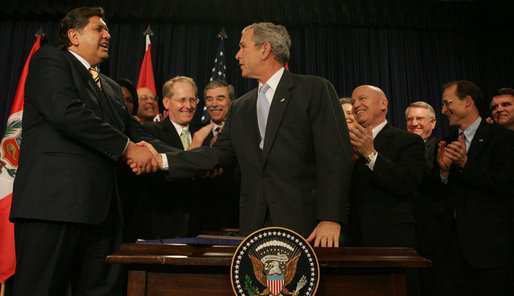 "President George W. Bush shakes the hand of Peru's President Alan Garcia after signing H.R. 3688, the United States-Peru Trade Promotion Agreement Implementation Act, Friday, Dec. 14, 2007, in the Dwight D. Eisenhower Executive Office Building. In signing the agreement, the President said, ""Peru and the United States are strong partners and today we're making that partnership even stronger."" White House photo by Joyce N. Boghosian"