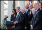 President George W. Bush, joined by Vice President Dick Cheney and members of his Cabinet, speaks with reporters in the Rose Garden, Friday, Dec. 14, 2007, where President Bush congratulated the Senate for passing a good energy bill, and urged Congress to move forward with spending legislation to fund the day to day operations of the federal government. President Bush also said he hoped those members of the press who attended a White House press reception Thursday evening had a good time, and joked that some silverware might be missing. White House photo by Eric Draper