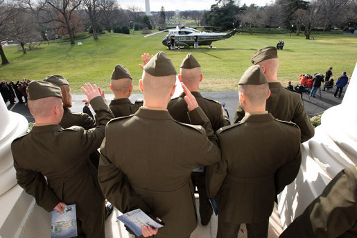 Marines from Quantico Marine Base Delta Company 1st Platoon look on as President George W. Bush boards Marine One before departing the White House for his trip to Fredericksburg, Virginia, Monday, Dec. 17, 2007. White House photo by Eric Draper