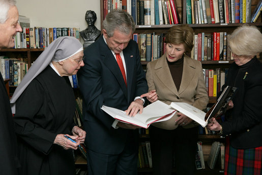 "President George W. Bush and Mrs. Laura Bush visit the ""book nook"" at the Little Sisters of the Poor Tuesday, Dec. 18, 2007, in Washington, D.C. With them are, from left: Archbishop Donald Wuerl of the Archdiocese of Washington, Mother Benedict de la Passion, Superior and President of Little Sisters of the Poor, and Mary Ann Lucey, volunteer librarian. White House photo by Chris Greenberg"
