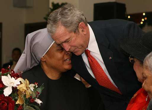 President George W. Bush shares a moment with a staff member at the Little Sisters of the Poor in Washington, D.C., Tuesday, Dec. 18, 2007, during his visit with Mrs. Laura Bush to the facility that provides nursing and assisted-living services to elderly people of lesser means. White House photo by Shealah Craighead