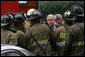President George W. Bush thanks firefighters from the District of Columbia after they battled an early morning blaze Wednesday, Dec. 19, 2007, at the Eisenhower Executive Office Building on the White House complex. White House photo by Chris Greenberg