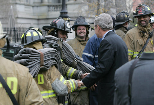 President George W. Bush shakes the hands of Washington, D.C. firefighters Wednesday, Dec. 19, 2007, after they battled a morning blaze at the Eisenhower Executive Office Building on the White House complex. White House photo by Chris Greenberg