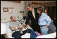 President George W. Bush visits U.S. Navy Hospital Corpsman Christopher Braley and his mother, Debra Braley, of Manteca, Calif., at the National Naval Medical Center in Bethesda, Md., Wednesday, Dec. 19, 2007. Braley is recovering from injuries sustained in Operation Iraqi Freedom. White House photo by Joyce N. Boghosian