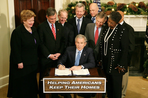 President George W. Bush signs into law H.R. 3648, the Mortgage Forgiveness Debt Relief Act of 2007, during ceremonies Thursday, Dec. 20, 2007, in the Roosevelt Room of the White House. White House photo by Eric Draper