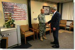 President George W. Bush presents the Purple Heart medal to US Army PFC Jeddah DeLoria of Chosen, Colo., Thursday, Dec. 20, 2007 at the Walter Reed Army Medical Center in Washington, D.C. DeLoria is recovering from injuries sustained in Operation Enduring Freedom in Afghanistan. White House photo by Joyce N. Boghosian