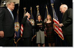 President George W. Bush stands next to Lt. Gen. James Peake (Ret.), as he's administered the Oath of Office Thursday, Dec. 20, 2007, as Secretary of Veterans Affairs by Vice President Dick Cheney. Looking on during the ceremonial swearing-in at the U.S. Department of Veterans Affairs are Secretary Peake's wife, Janice, and daughter, Kimberly. White House photo by Chris Greenberg