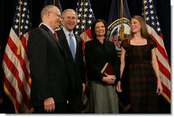 President George W. Bush smiles as he stands with Secretary of Veteran Affairs Lt. Gen. James Peake (Ret.), his wife, Janice, and daughter, Kimberly, after the former Army Surgeon General was sworn in during the ceremonial event Thursday, Dec. 20, 2007, at the U.S. Department of Veterans Affairs. White House photo by Chris Greenberg