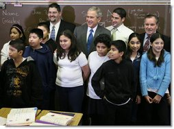 President George W. Bush is joined by Principal Carlos Azcoitia, left; teacher Rene Camler and Chicago Mayor Richard M. Daley, right, Monday, Jan. 7, 2008, during a visit with students and staff at the Horace Greeley Elementary School in Chicago. White House photo by Joyce N. Boghosian