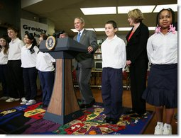 President George W. Bush visits with students Monday, Jan. 7, 2008, at the Horace Greeley Elementary School in Chicago, joined by U.S. Secretary of Education Margaret Spellings, right, where President Bush also delivered a statement highlighting the successes of No Child Left Behind and urged Congress to reauthorize it. White House photo by Joyce N. Boghosian