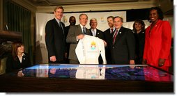 "President George W. Bush and Chicago Mayor Richard Daley hold up a T-shirt touting Chicago 2016, during a meeting Monday, Jan. 7, 2008, with with members of the Chicago 2016 Bid Committee and the U.S. Olympic Committee. Said the President, ""This country supports your bid, strongly. And our hope is that the judges will take a good look at Chicago and select Chicago for the 2016 Olympics."" White House photo by Joyce N. Boghosian"