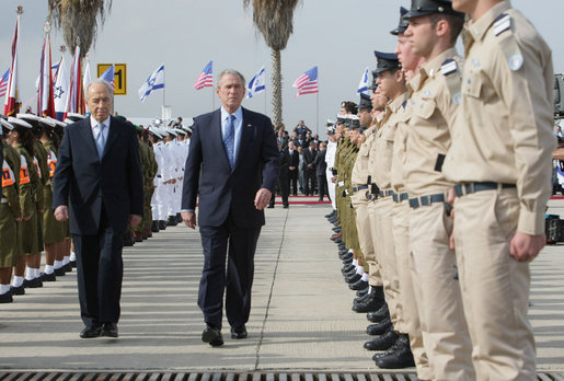 President George W. Bush and Israel's Shimon Peres review the troops during an arrival ceremony Wednesday, Jan. 9, 2008, at Ben Gurion International Airport. President Bush arrived in Tel Aviv on the first stop of his eight-day, Mideast visit. White House photo by Eric Draper
