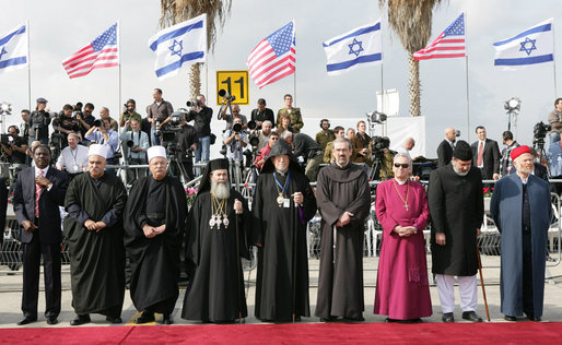 Clergymen wait alongside the red carpet Wednesday, Jan. 9, 2008, in anticipation for the arrival of Air Force One and President George W. Bush to Ben Gurion International Airport in Tel Aviv. The arrival of the President marked the first day of his eight-day Mideast trip. White House photo by Chris Greenberg