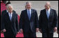 President George W. Bush and Israel's Prime Minister Ehud Olmert smile as they join Israeli President Shimon Peres for arrival ceremonies Wednesday, Jan. 9, 2008, after President Bush's arrival in Tel Aviv. White House photo by Chris Greenberg