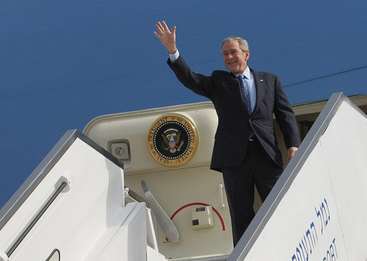 President George W. Bush stands at the top of the stairs to Air Force One Wednesday morning, Jan. 9, 2008, after arriving at Ben Gurion International Airport for the start of his Mideast visit. White House photo by Eric Draper