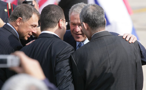 President George W. Bush is greeted by well-wishers along the red carpet at Ben Gurion International Airport Wednesday, Jan. 9, 2008, after arriving in Tel Aviv to begin his eight-day, Mideast visit. White House photo by Chris Greenberg