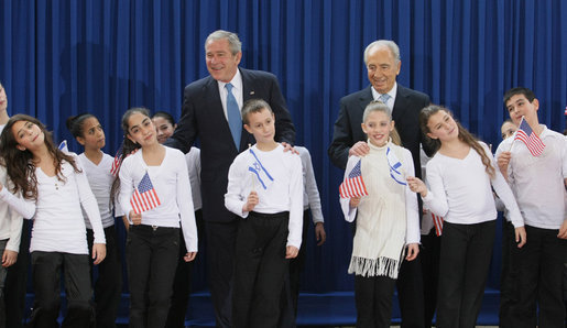 President George W. Bush poses with President Shimon Peres of Israel and 10 children who performed during their meeting Wednesday, Jan. 9, 2008, at the President Peres' residence in Jerusalem. White House photo by Eric Draper