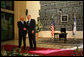 President George W. Bush and President Shimon Peres of Israel shake hands after meeting Wednesday, Jan. 9, 2008, at the Israeli President's residence in Jerusalem. White House photo by Eric Draper