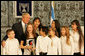 President George W. Bush poses with singers Wednesday, Jan. 9, 2008, at the President's Residence in Jerusalem, where he met with his Israeli counterpart Shimon Peres. White House photo by Chris Greenberg