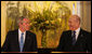 President George W. Bush listens as Prime Minister Ehud Olmert of Israel commends him Wednesday, Jan 9, 2008, during their joint press availability in Mr. Olmert's Jerusalem office. White House photo by Chris Greenberg