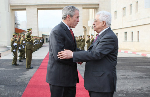 "President George W. Bush and President Mahmoud Abbas of the Palestinian Authority embrace at the end of the red carpet as they end their meeting Thursday, Jan. 10, 2008, in Ramallah. Said the President, ""É Is it possible for the Israelis and the Palestinians to work out their differences on core issues so that a vision can emerge? And my answer is, absolutely."" White House photo by Eric Draper"